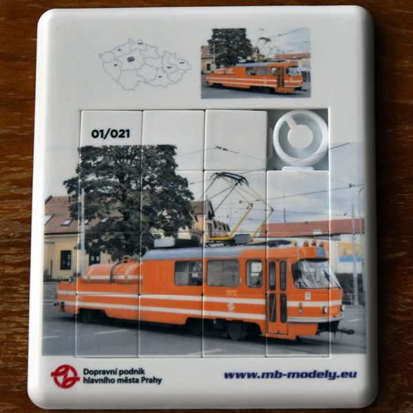 Folding puzzler with theme tramway